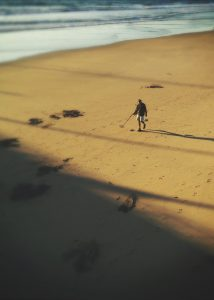 Photograph of a treasure hunter on the beach