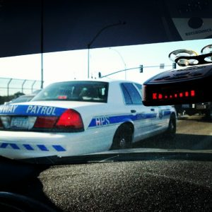 A radar detector unit being triggered at a police car nearby
